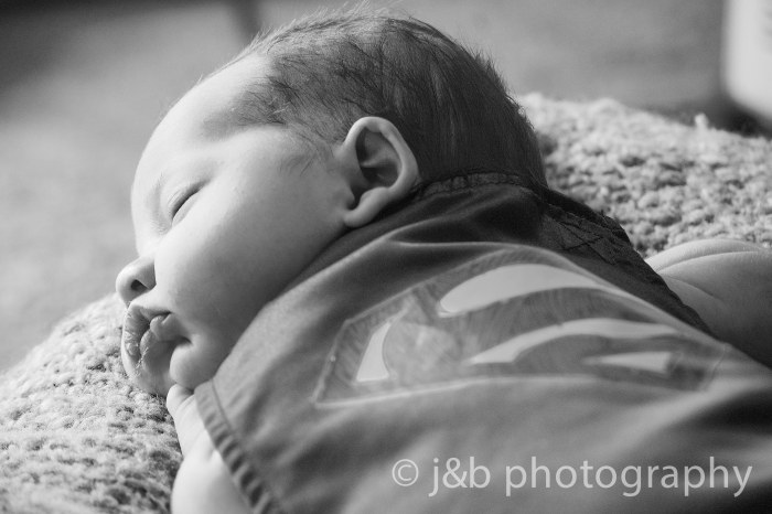 14 Newborn boy superman black and white