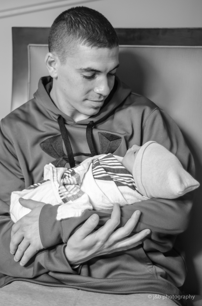 16 Birth photo proud dad holding son
