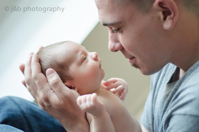 22 Newborn dad looking at baby