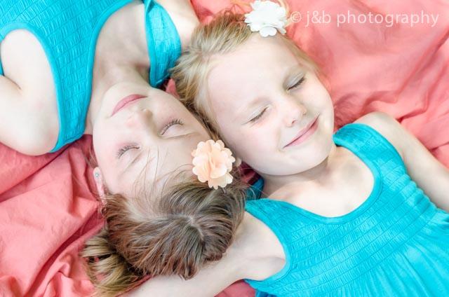 18 sweet sisters on blanket outside